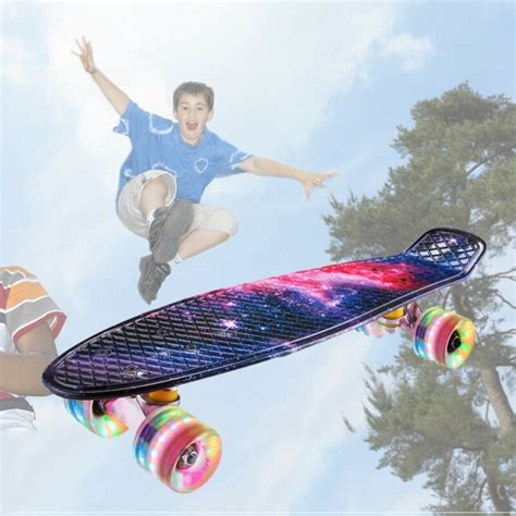 """Plastic Penny Size Board 22"""" Red With Blue Wheels White"""